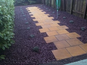 Bricks With Black Pebble Patio.Jpg
