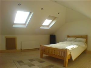 Attic guest room with double bed
